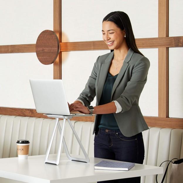 woman working on vari portable laptop stand